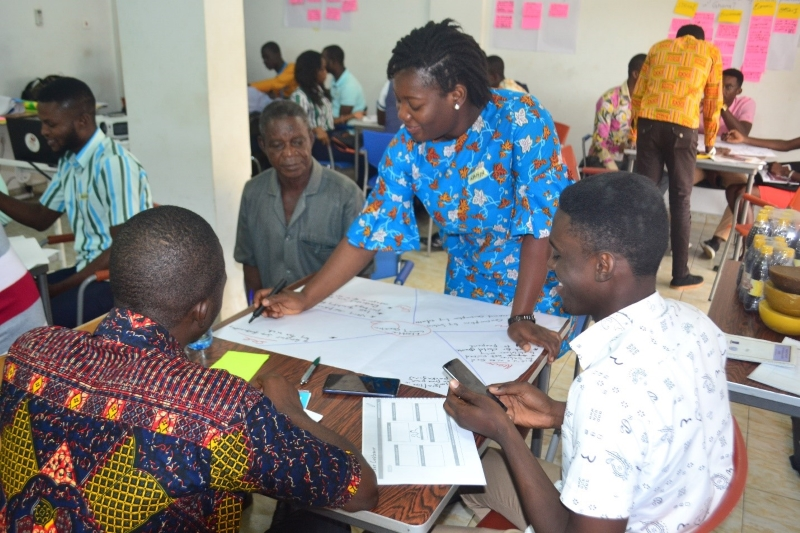Rahina Sidiki Alare and other group members developing a customer empathy map of their proposed businesses